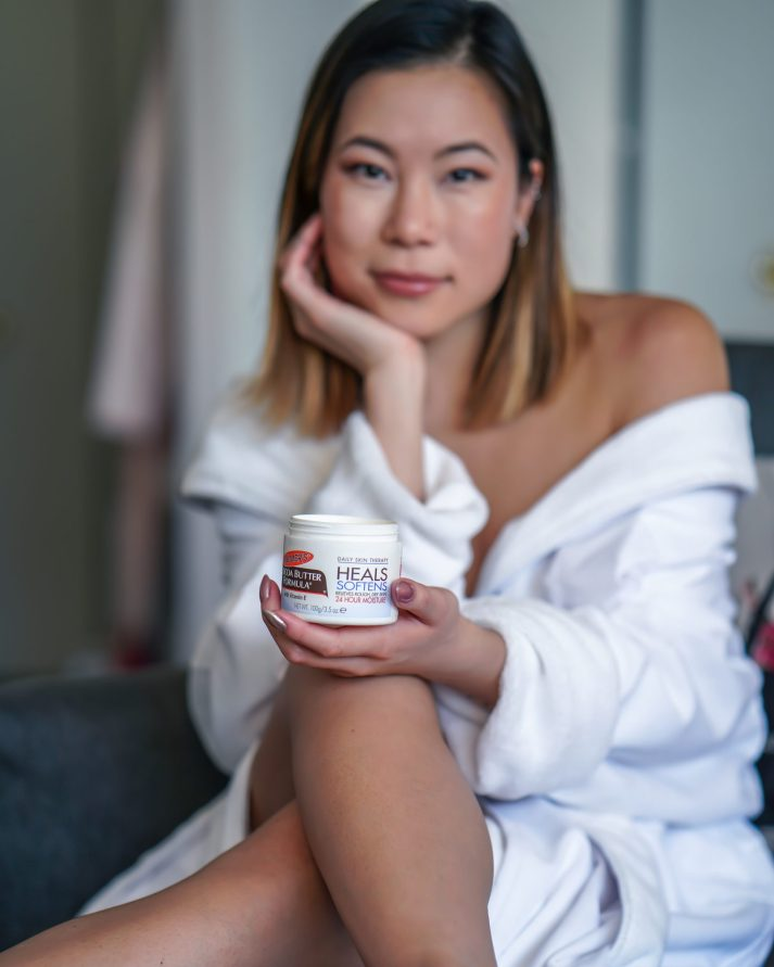 Kasey Ma Lifestyle Influencer of TheStyleWright Holds Palmer's Coconut Butter Formula Jarfor dry skincare