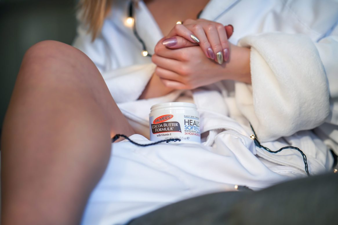 Kasey Ma Beauty Influencer of TheStyleWright Applies Palmer's Coconut Butter Formula to dry cuticles and hands for moisturizing for dry skincare