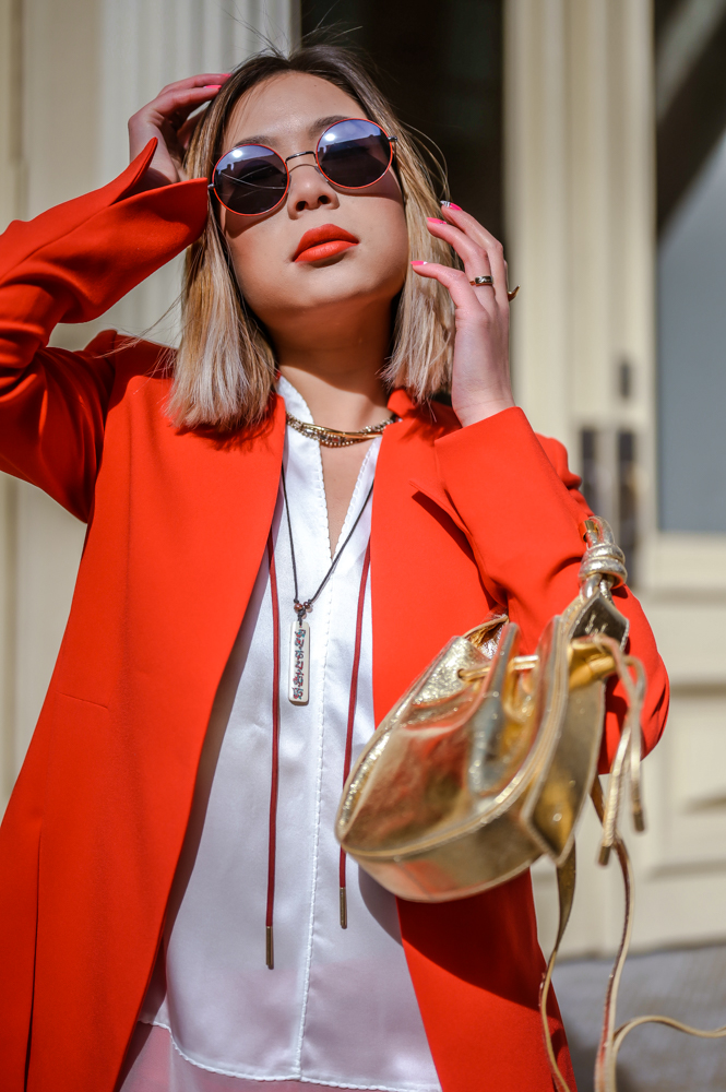 Kasey Ma fashion blogger of TheStyleWright wears a red powersuit by Elie Tahari to New York fashion week 2019