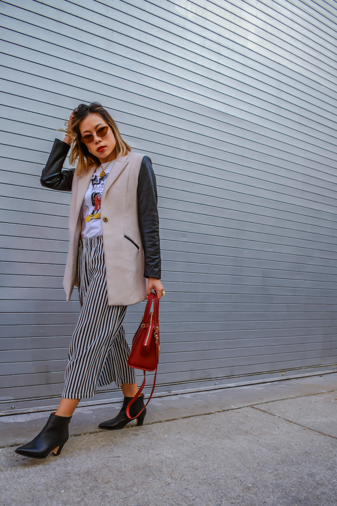 Fashion blogger/influencer Kasey Ma of TheStyleWright turns UNIQLO Mickey Mouse tee into a minimal, modern, and edgy look for New York Fashion Week 2019 by pairing it with a Dan Liu coat, Express pants, and Bill Blass Payton booties