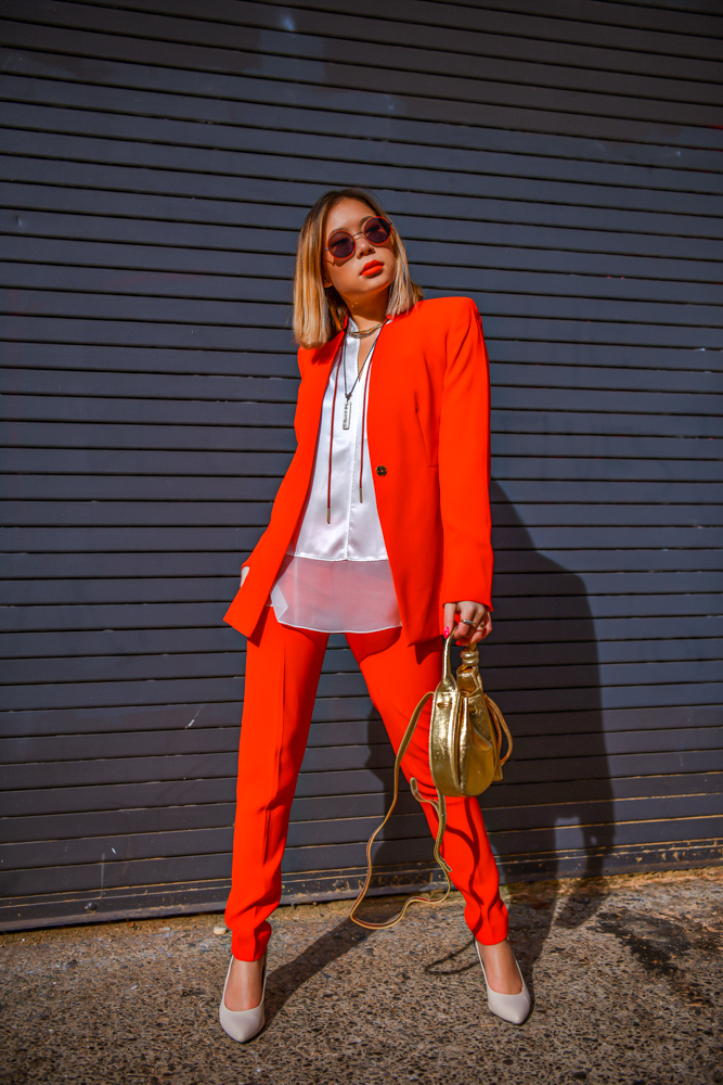 Kasey Ma of The StyleWright wearing matching red Ellie Tahari suit