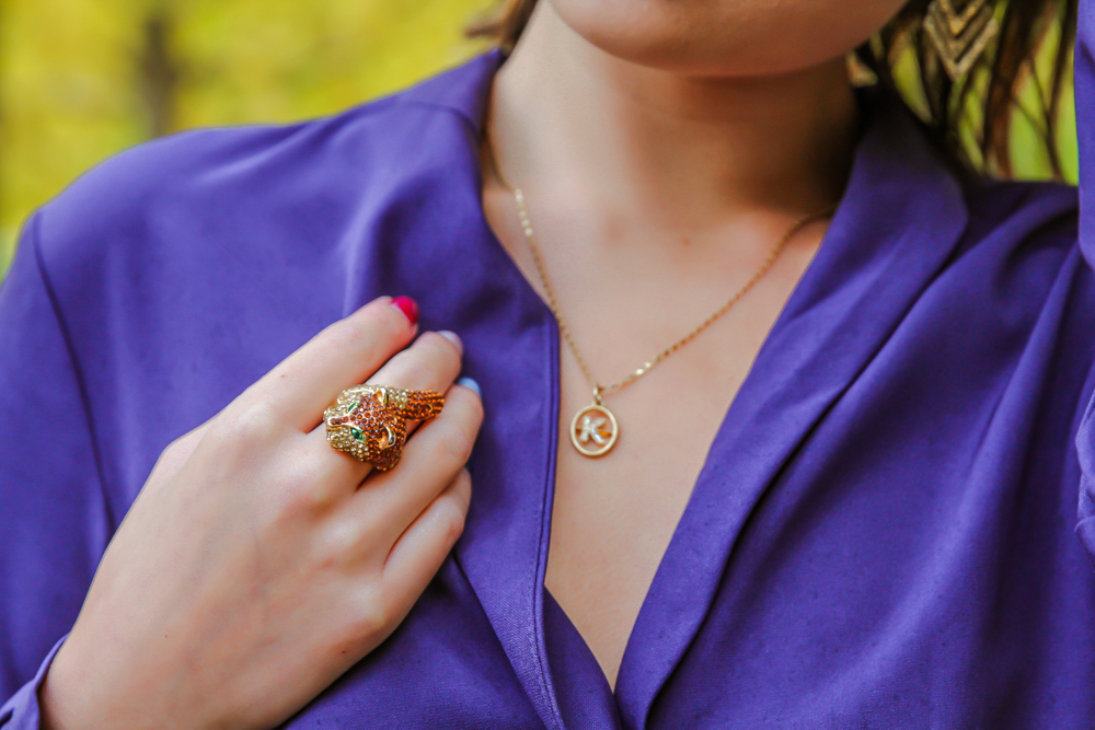 kasey ma of thestylewright wearing blue jumpsuit with statement piece ring and necklace jewelry