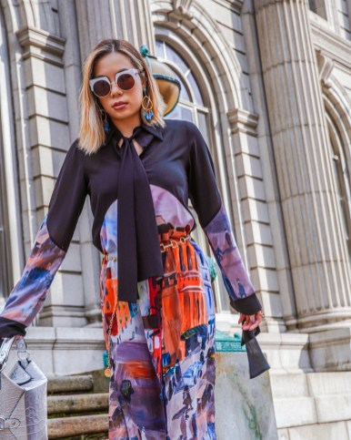 kasey ma in indonesian diversity for new york fashion week holding a jeff wan bag and wearing bill blass shoes NYFW
