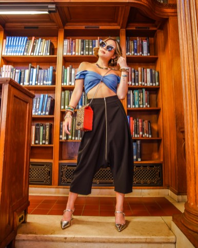 kasey ma of the stylewright in a femme luxe top, marste pants sequin jewelry necklace, and a jeff wan bag for new york fashion week 2019