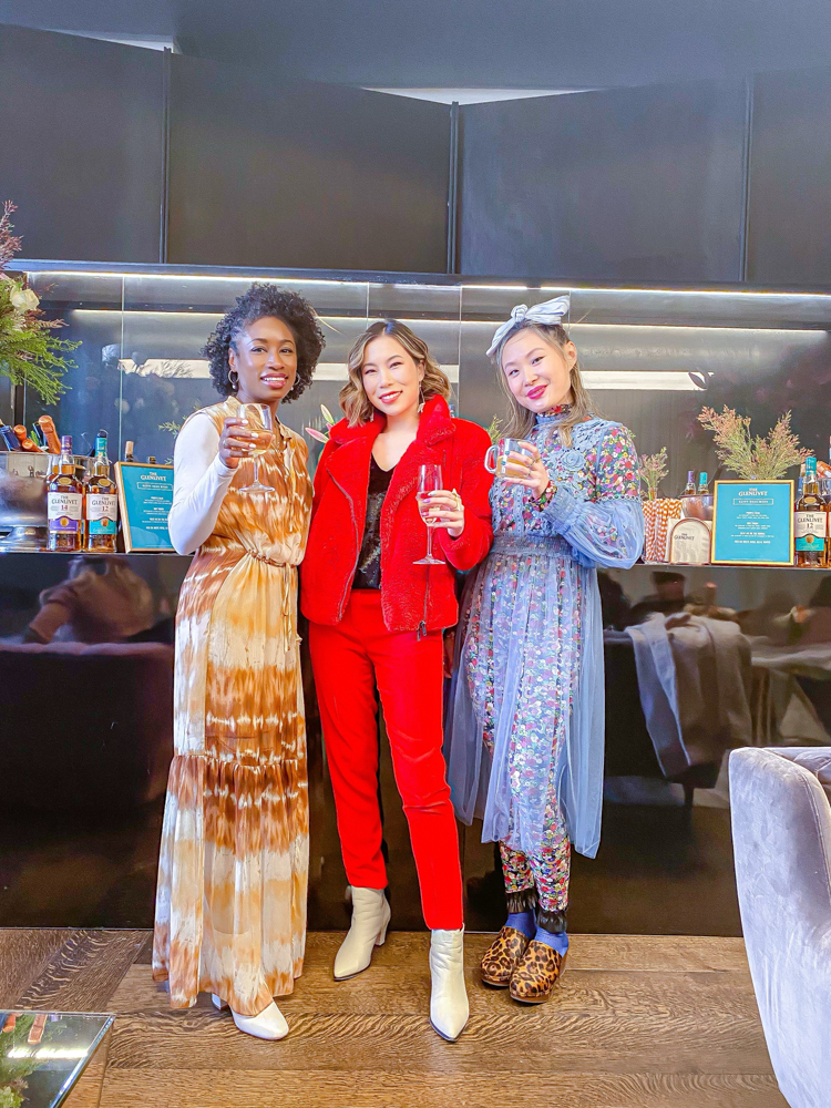 Kasey Ma of TheStyleWright Wearing Rebecca Minkoff Faux Fur Coat as she heads to NYFW 2020. She is pictured with her friends Mary and Gail inside Spring Studios