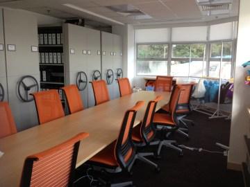 Meeting area, plus compactor.