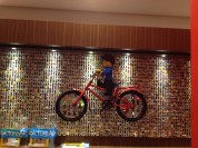 If you look carefully, the wheels magnify all the minifigures behind on the wall.