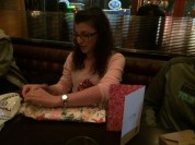 Rachel is a careful unwrapper of presents.