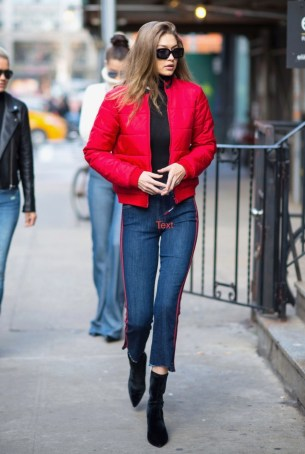 January 29, Red Tommy Hilfiger bomber, black sweater, red striped cropped flare Mother Denim, velvet booties and rectangular sunglasses