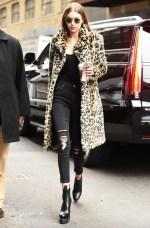 January 23, Leopard coat, black top, Ksubi black distressed jeans, Versace platform ankle boots and rounded sunglasses