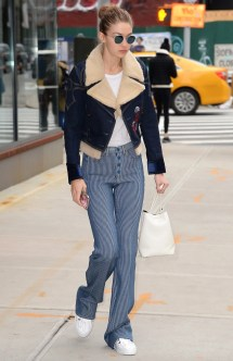 January 23, Denim shearling jacket, white tee, high-waisted blue pinstriped flare pants, white sneakers, a white bucket bag and Krewe sunglasses