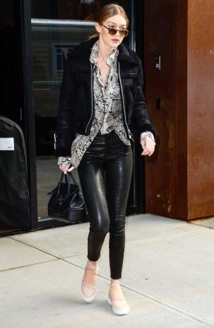 February 1, Black shearling jacket, printed blouse, leather pants, peach sneakers, Versace handbag and rounded sunglasses