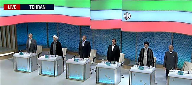 State guardando il dibattito televisivo tra i candidati alla presidenza in Iran?