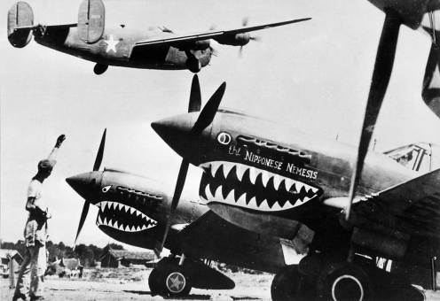 Liberator_bomber_crosses_the_P-40_fighter_planes