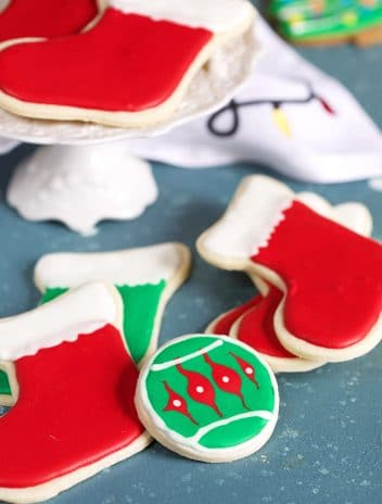 christmas cutout sugar cookies on a blue background.