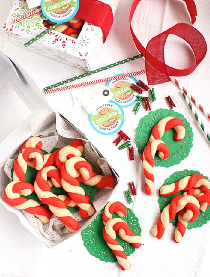 Candy cane cookies being packaged in a box.