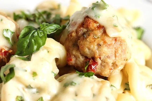 Ricotta Meatballs with Sun-Dried Tomatoes and Garlic Asiago Cream Sauce | The Suburban Soapbox #meatballs #maggianos