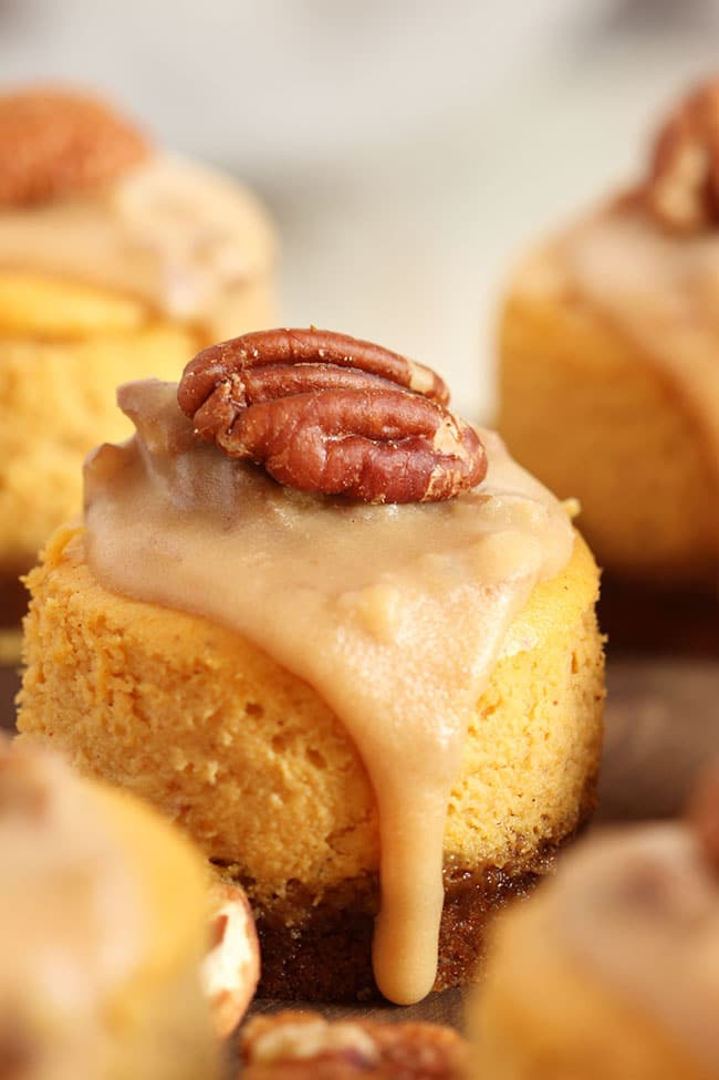 Mini Pumpkin Cheesecakes with a drip on the side.