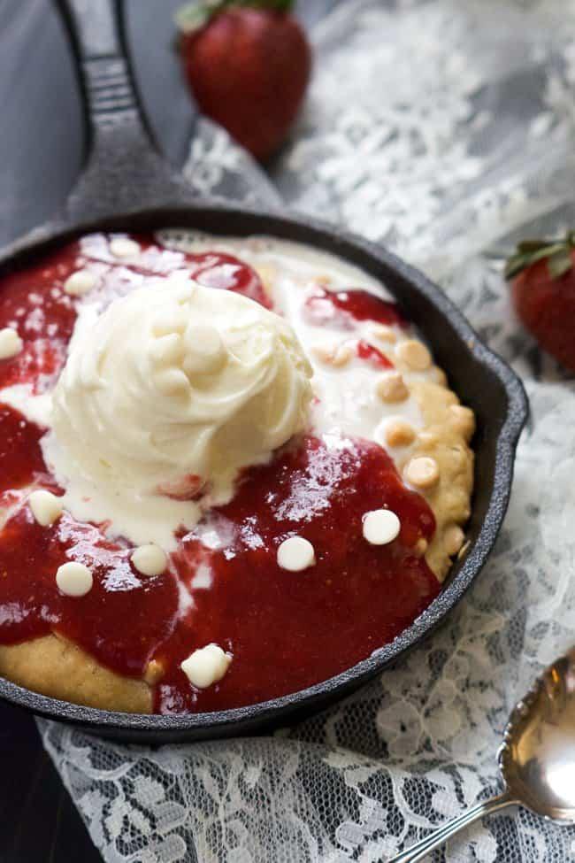 Vanilla-Custard-Lemon-White-Chocolate-Sugar-Cookie-Skillet-with-Strawberry-Sauce-WithSaltandWit