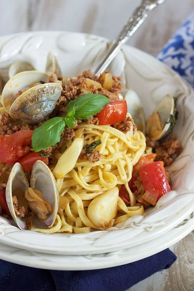 This easy Linguine with Clams Chorizo and Roasted Tomatoes is loaded with flavor and is ready in about 30 minutes. From TheSuburbanSoapbox.com