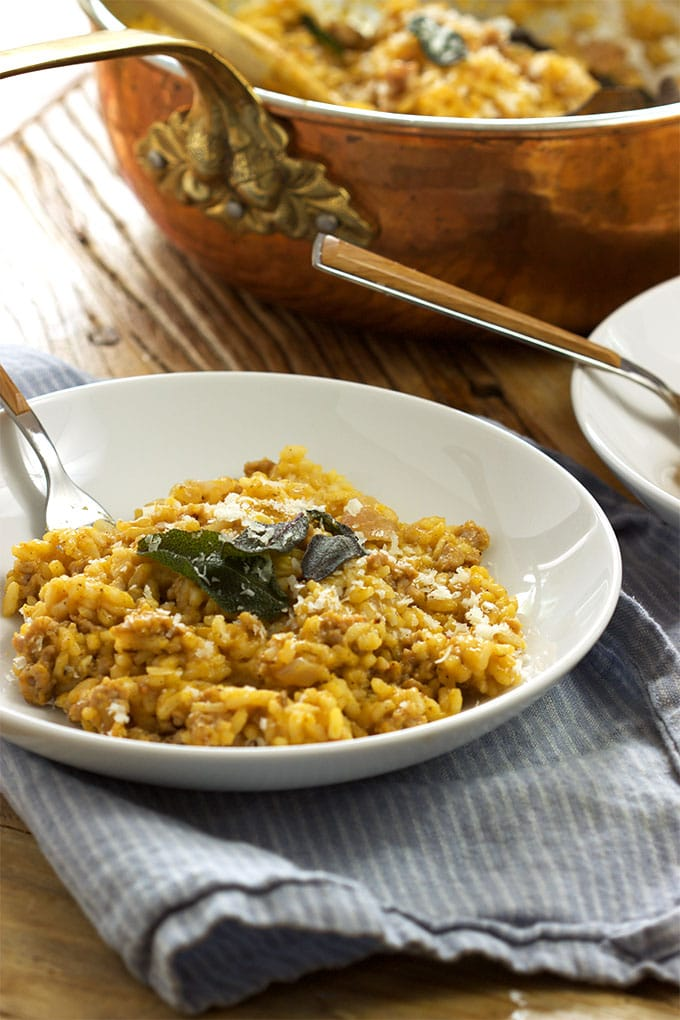 Creamy, rich Butternut Squash Risotto with Sausage and Crispy Sage is the perfect fall meal for entertaining. Simple and stunning from TheSuburbanSoapbox.com.
