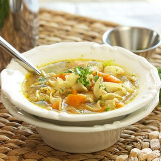 The Best Chicken Noodle Soup recipe ever, perfect for crisp fall nights! | TheSuburbanSoapbox.com