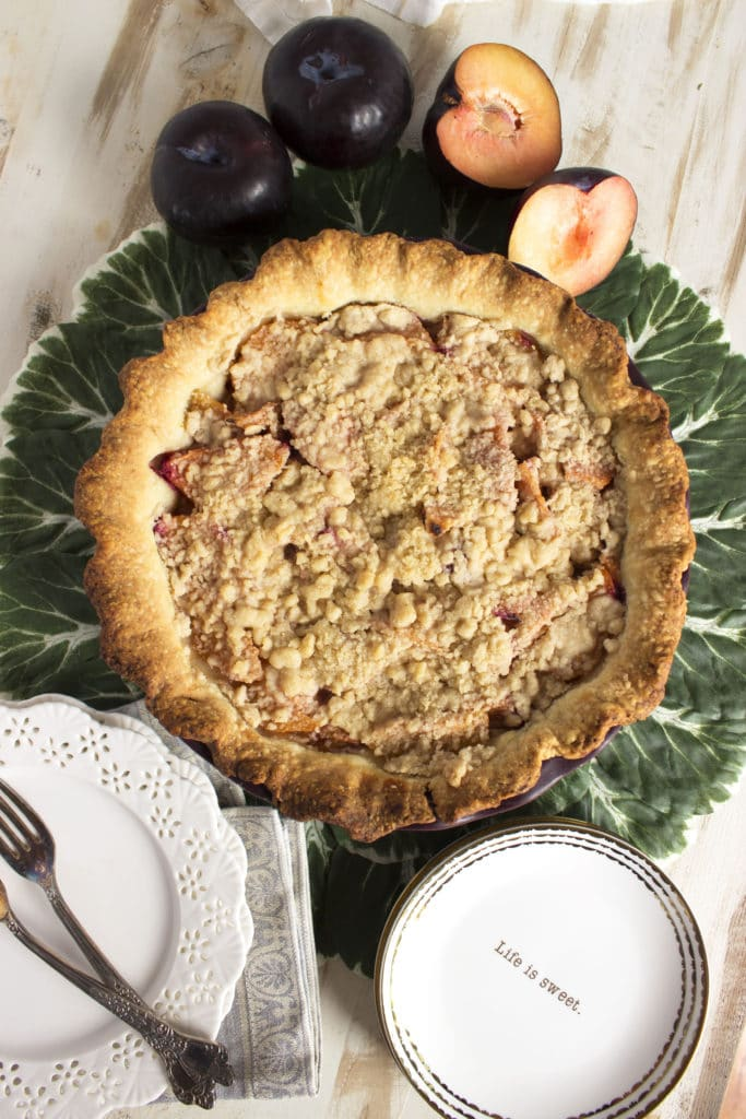 This super easy Streusel Plum Pie recipe is like a sweet plum crisp nestled in a buttery pie crust. Perfection from TheSuburbanSoapbox.com.
