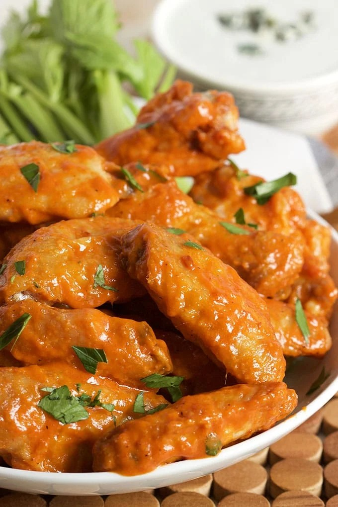 Easy to make and perfect for game day, the BEST Baked Buffalo Wings Recipe ever. A tailgating staple! | TheSuburbanSoapbox.com