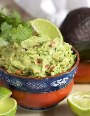 Super easy to make, this is the Very BEST Guacamole recipe ever. A must for game day. | TheSuburbanSoapbox.com