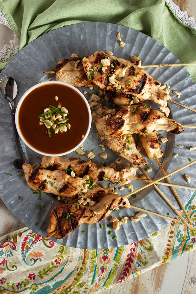 Quick, healthy and bursting with flavor. Satay Chicken with Spicy Peanut Sauce is a weeknight dinner recipe staple! | TheSuburbanSoapbox.com