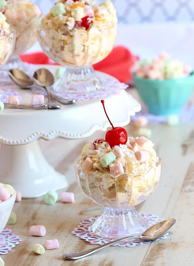 Ready in minutes, this easy Ambrosia Salad recipe is the BEST for parties and holiday gatherings. | TheSuburbanSoapbox.com