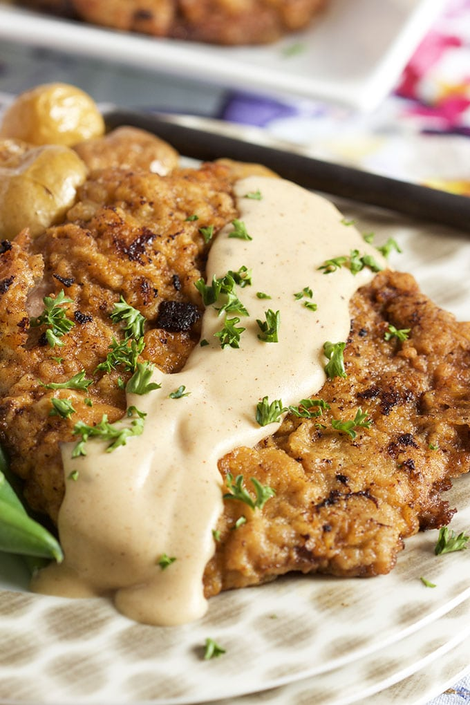 Ready in 30 minutes, this easy Chicken Fried Steak with Country Gravy recipe is a family favorite. | TheSuburbanSoapbox.com