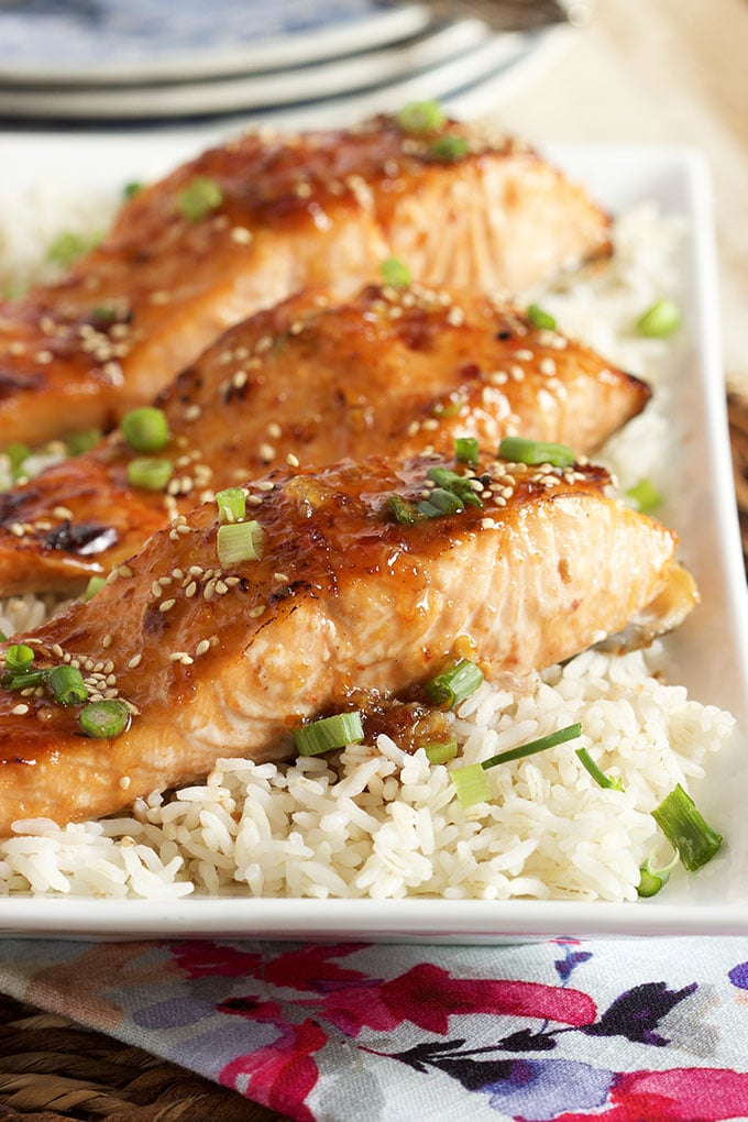 Easy to make and ready in 15 minutes, this Sweet Chili Orange Glazed Salmon recipe is a family favorite. | TheSuburbanSoapbox.com