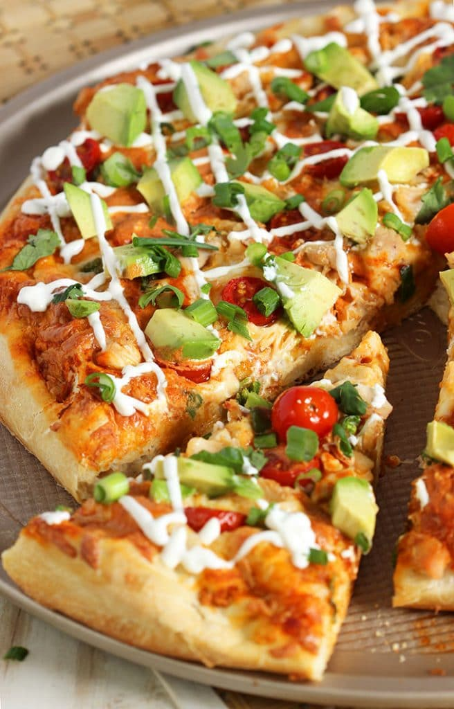 The best way to celebrate Pizza Friday and Cinco de Mayo, this Easy Chicken Enchilada Pizza recipe is ready in just 20 minutes! | TheSuburbanSoapbox.com