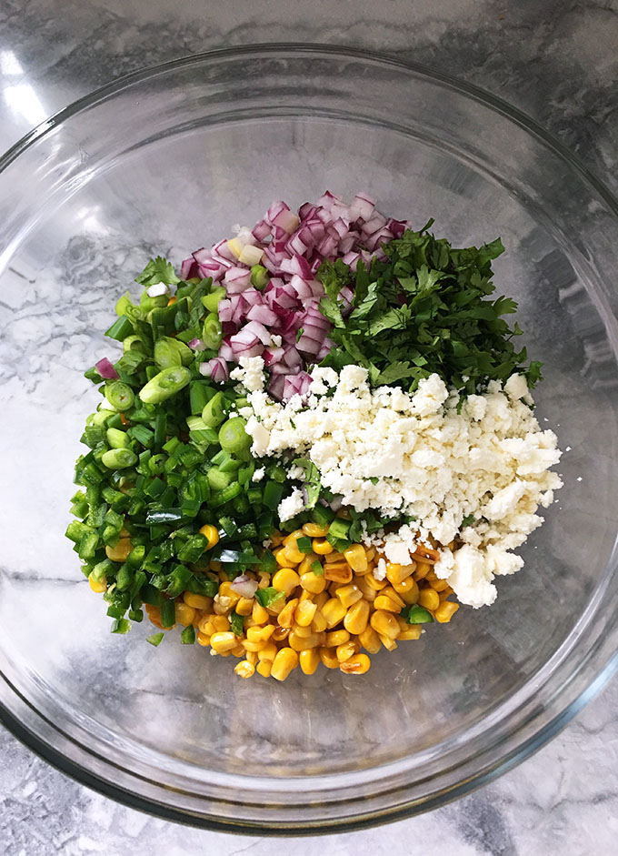 Quick and easy, Mexican Street Corn Salad is a fresh and bright side dish perfect for summer parties and Cinco de Mayo. | TheSuburbanSoapbox.com
