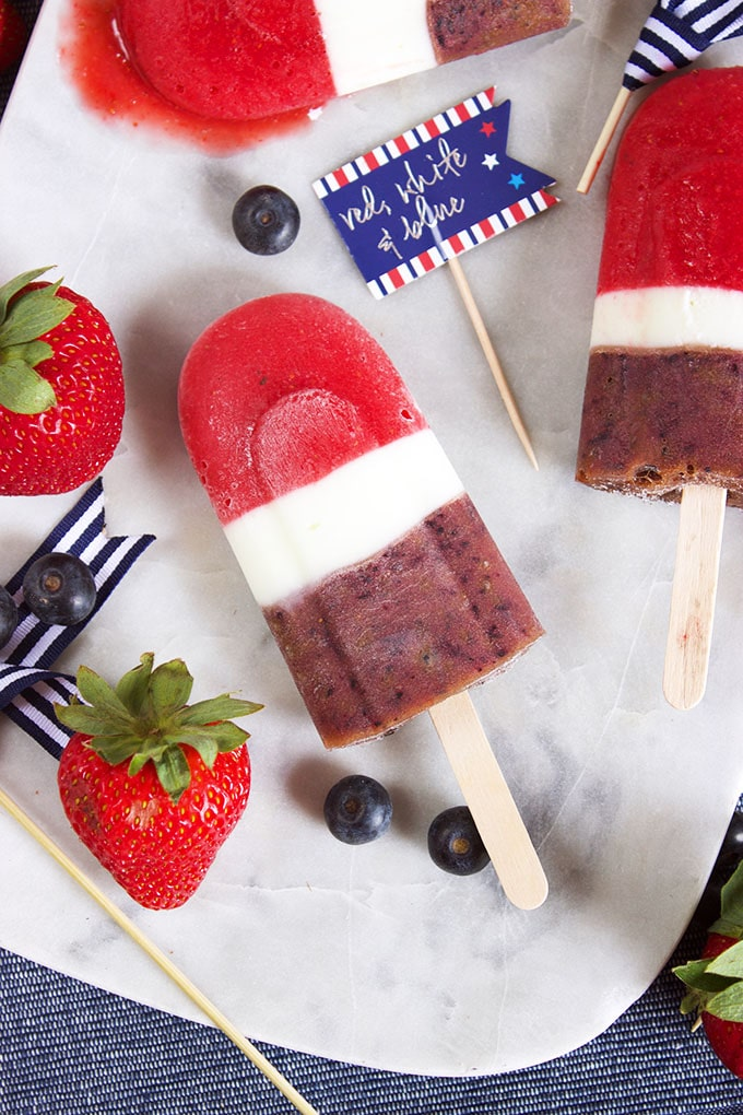 Super easy, healthy and sweet, the perfect dessert for summer. Red White and Blueberry Smoothie Popsicles are a hit with friends, families and guests of all ages! | TheSuburbanSoapbox.com