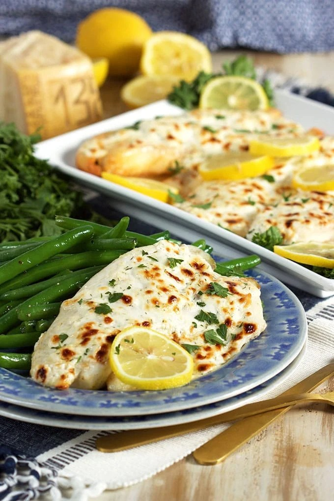 Super easy and ready in just 15 minutes, this Flaky Parmesan Tilapia is a huge hit with the entire family. TheSuburbanSoapbox.com