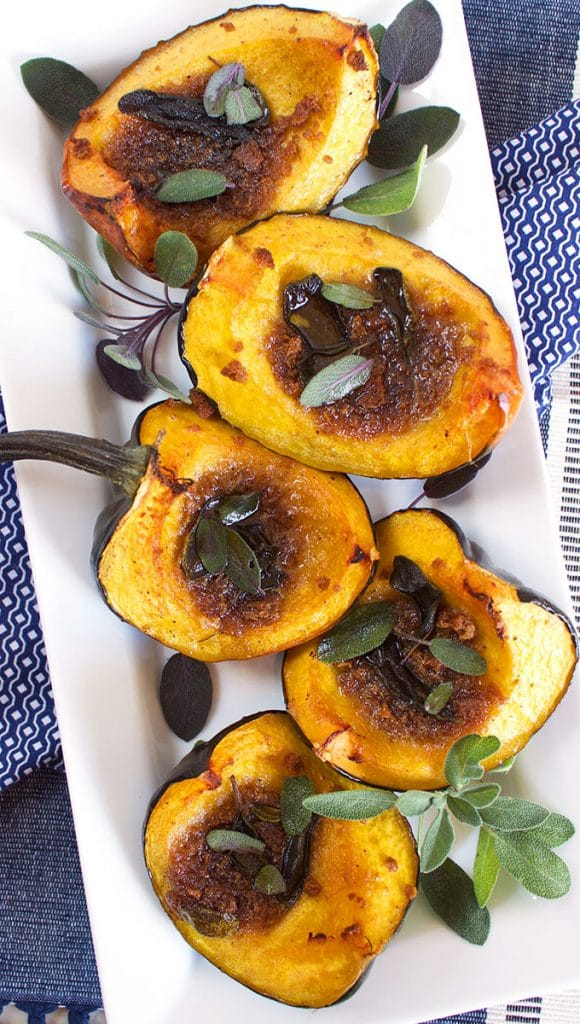 Quick and easy, Roasted Amaretto Gingersnap Acorn Squash is a festive side dish that's always a huge hit. Topped with a sweet/savory butter, this recipe is always a winner! TheSuburbanSoapbox.com