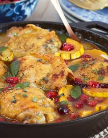 Ready in less than an hour, this one pot Maple Mustard Chicken Skillet with Cranberries and Delicata Squash is the dinner recipe your family will love. | theSuburbansoapbox.com