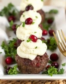 Super easy and ready in minutes, these simple Mini Meatloaf Cupcakes with Cranberry Glaze recipe is topped with your family's favorite leftover mashed potatoes! A great weeknight dinner! | TheSuburbanSoapbox.com
