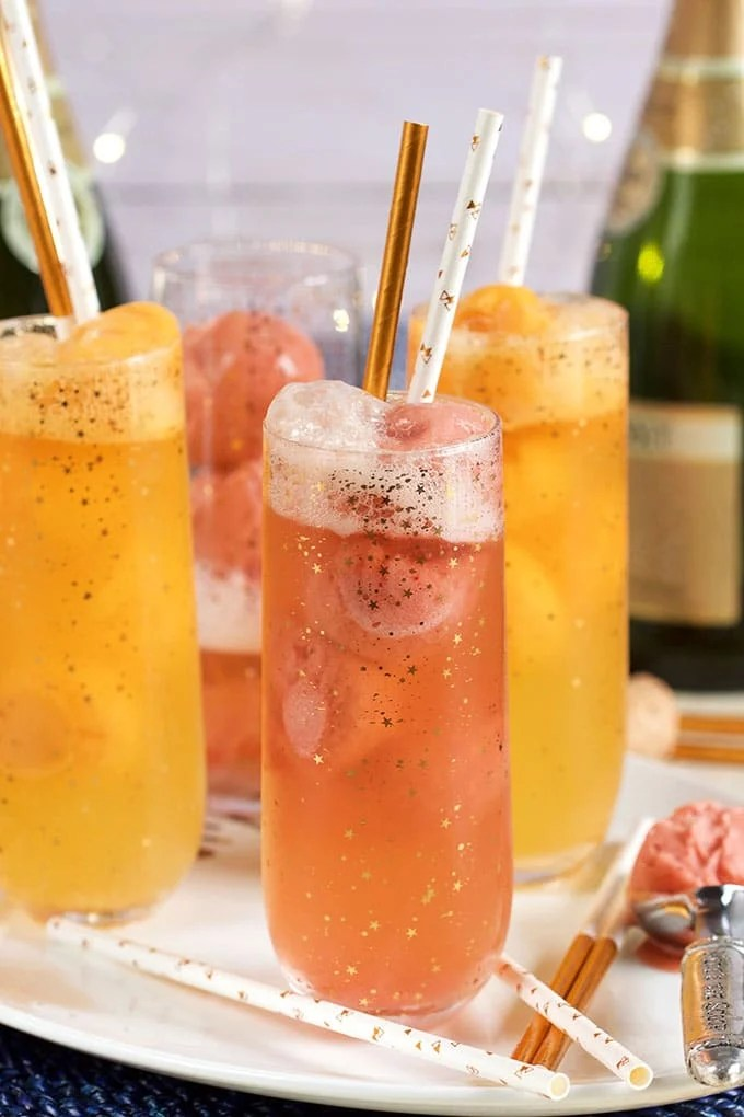 Fruity and festive, this Easy Mimosa Float Recipe is made with orange sorbet and champagne for a fun cocktail fit for any brunch celebration! | TheSuburbanSoapbox.com