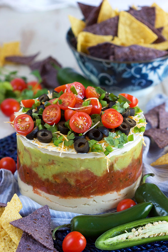 Ready in minutes, this 7 Layer Mexican Hummus Dip is the perfect addition to your game day menu! | TheSuburbanSoapbox.com