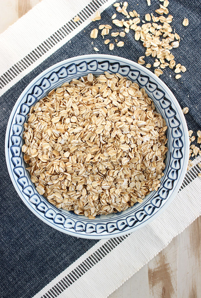 Easy to make Homemade Oat Flour in a blue and white bowl from TheSuburbanSoapbox.com