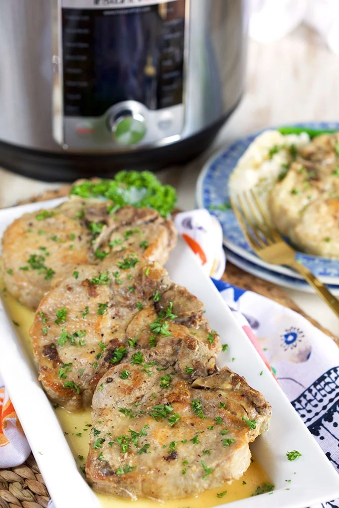Ready in a flash, these Instant Pot Pork Chops in a Dijon Pan Sauce are a great weeknight dinner OR elegant enough for entertaining! | TheSuburbanSoapbox.com @suburbansoapbox
