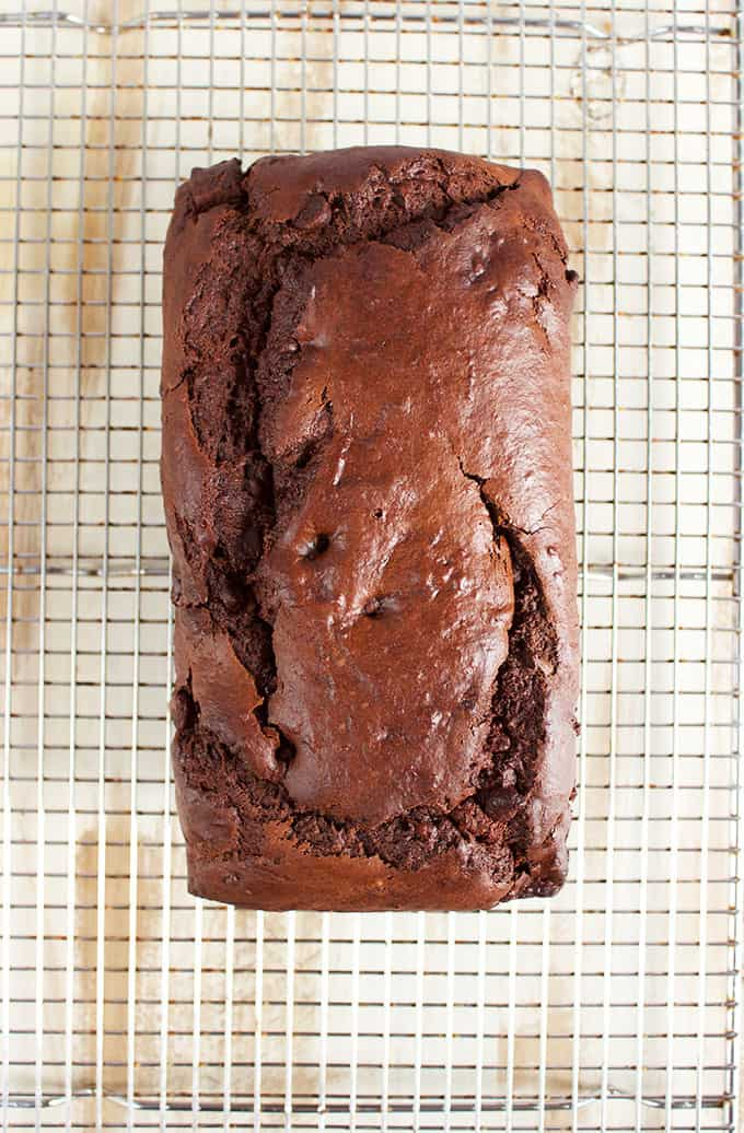 Triple Chocolate Banana Bread sliced on a marble platter. TheSuburbansoapbox.com
