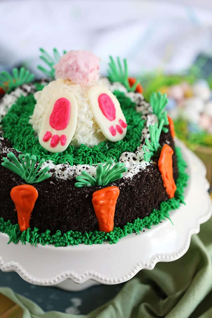 Oreo Ice Cream Cake decorated with white bunny butt with pink cotton candy tail and chocolate carrots from TheSuburbanSoapbox.com