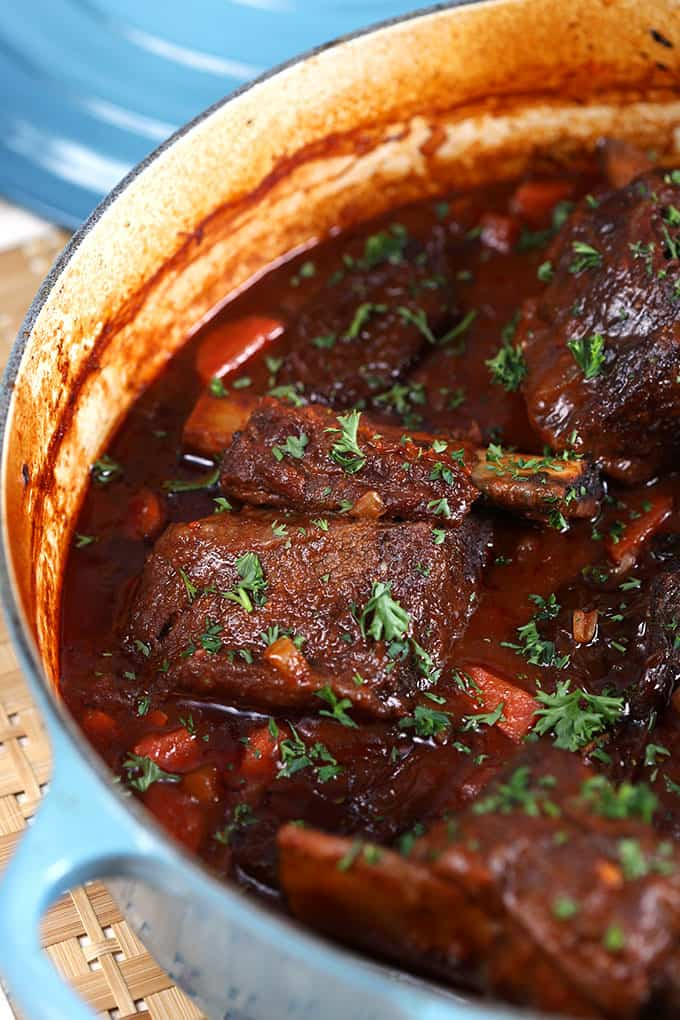 Braised Short Ribs in blue Le Creuset dutch oven from TheSuburbanSoapbox.com