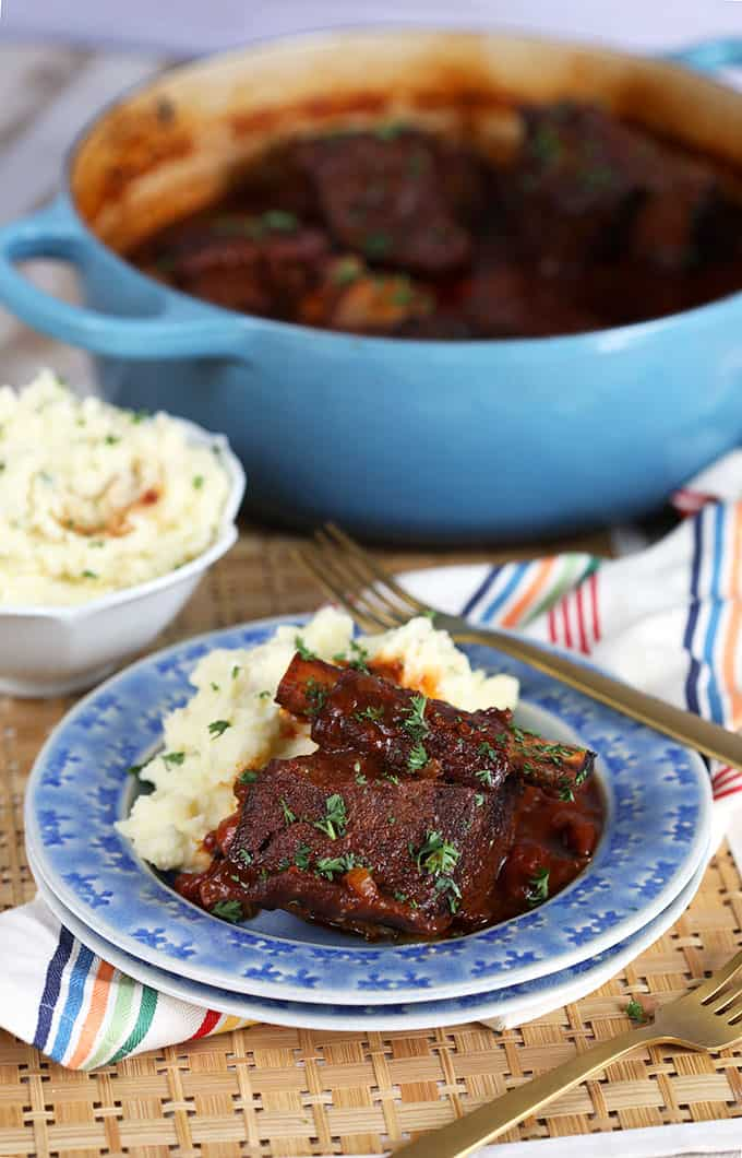 Braised Short Ribs on a blue plate with mashed potatoes | thesuburbansoapbox.com