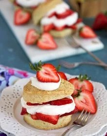 Homemade Strawberry Shortcake on a white plate with a pastry fork on a blue background from TheSuburbanSoapbox.com