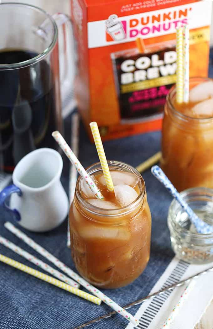 Cold Brew Coffee in a mason jar with Dunkin Donuts Cold Brew packets in background from TheSuburbanSoapbox.com